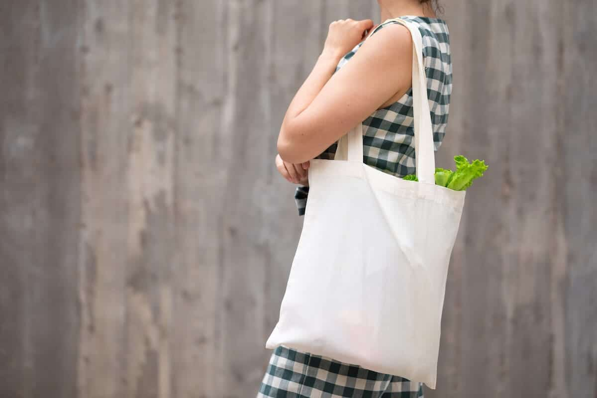 Photo of women with a white bag