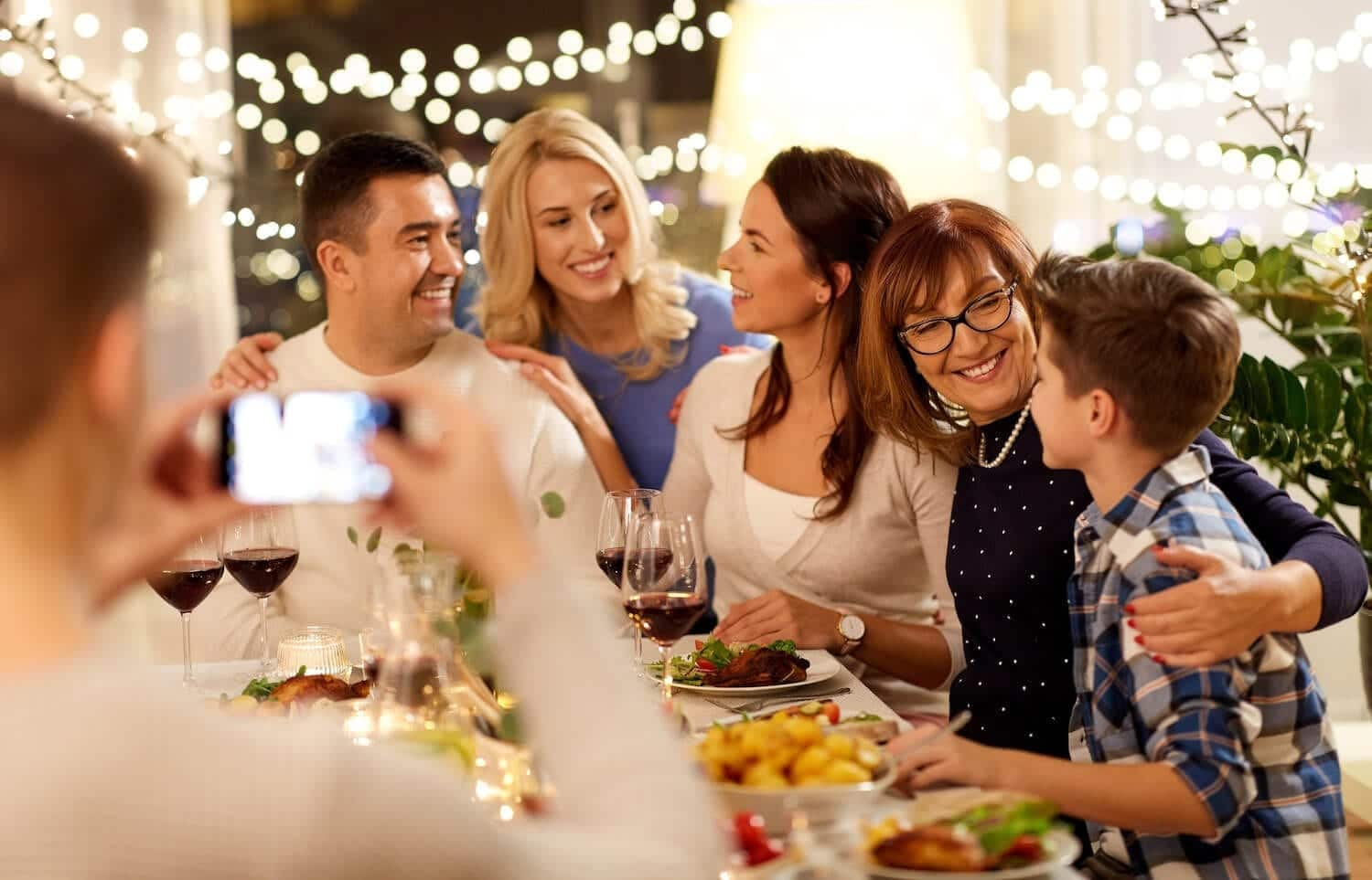 Photo of family taking a picture during dinner