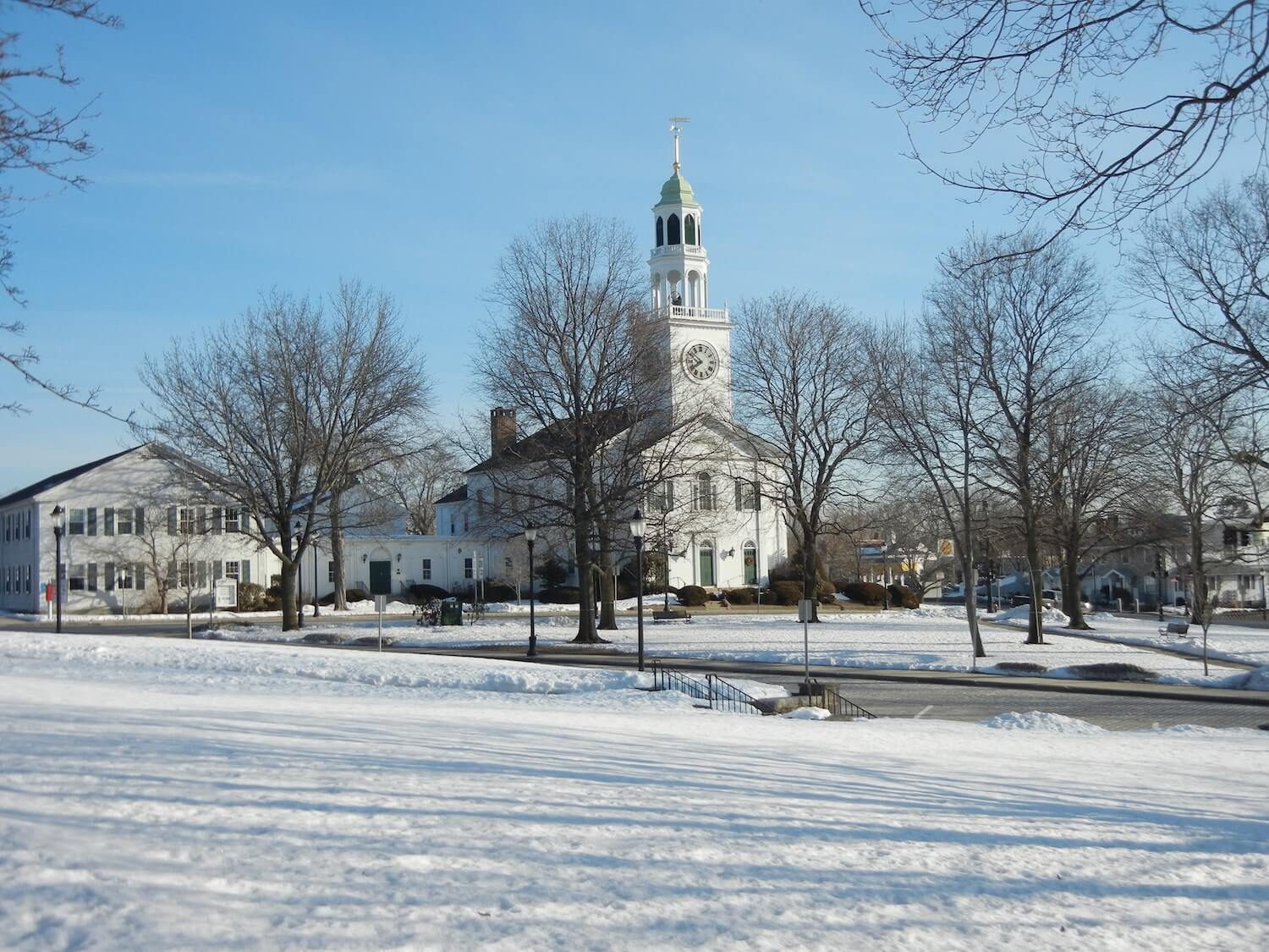 Landscape photo of church with the city covered in snow