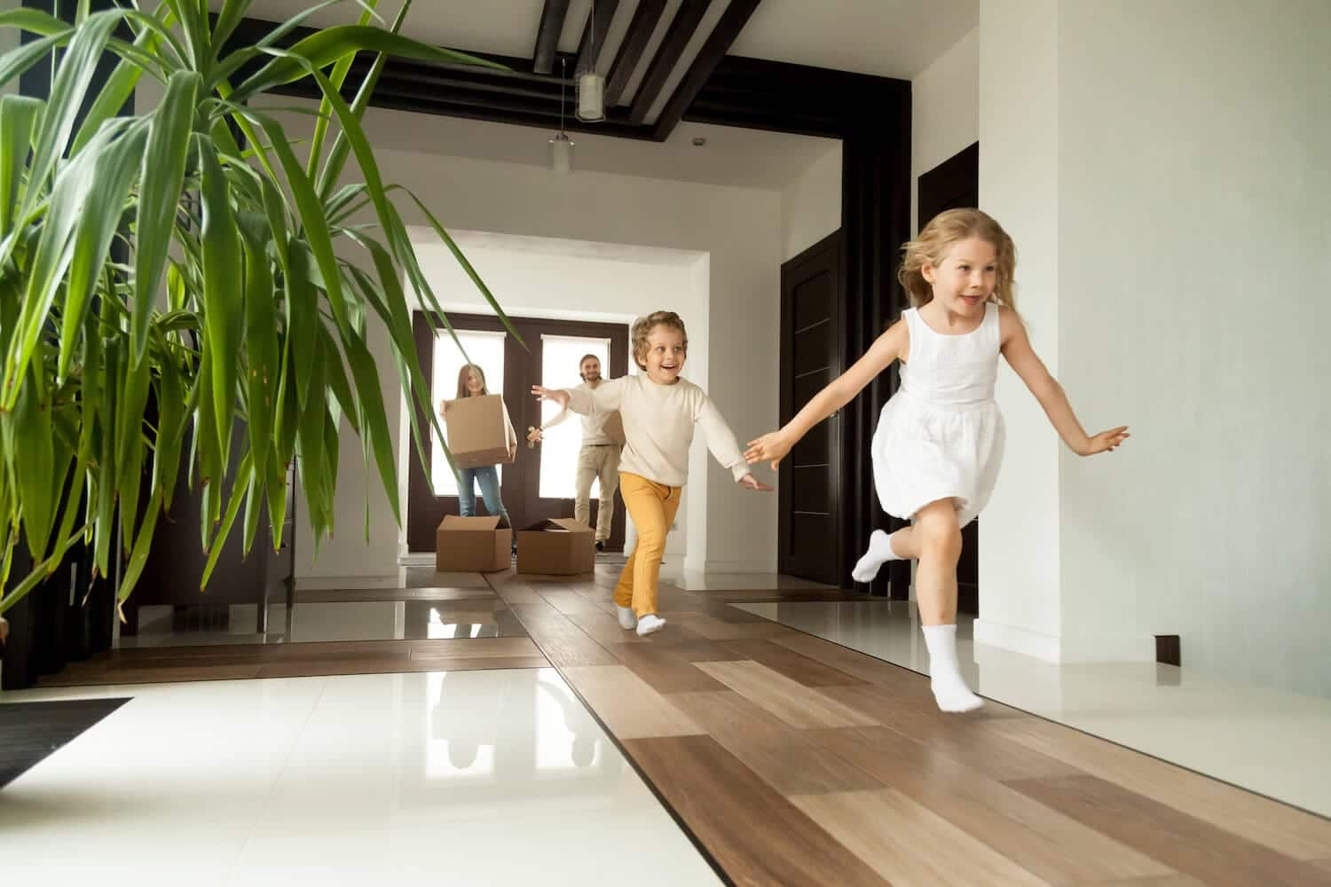 Image of family walking into their new home for the first time