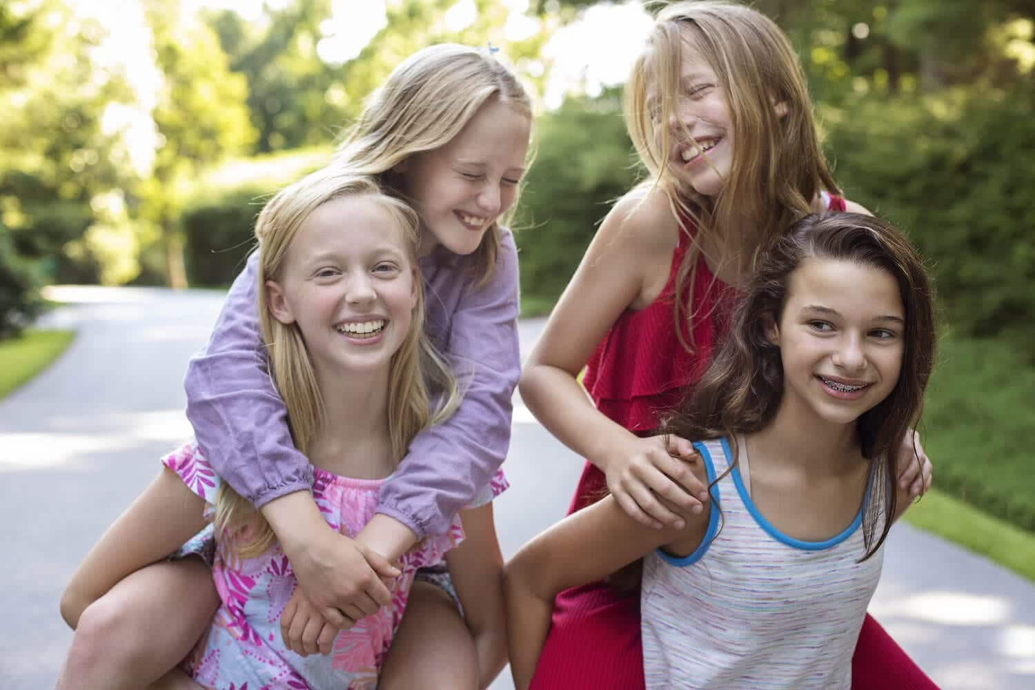Portrait of four girls playing on the street