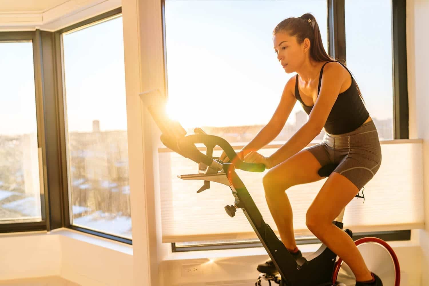 Image of woman exercising on a stationary bicycle