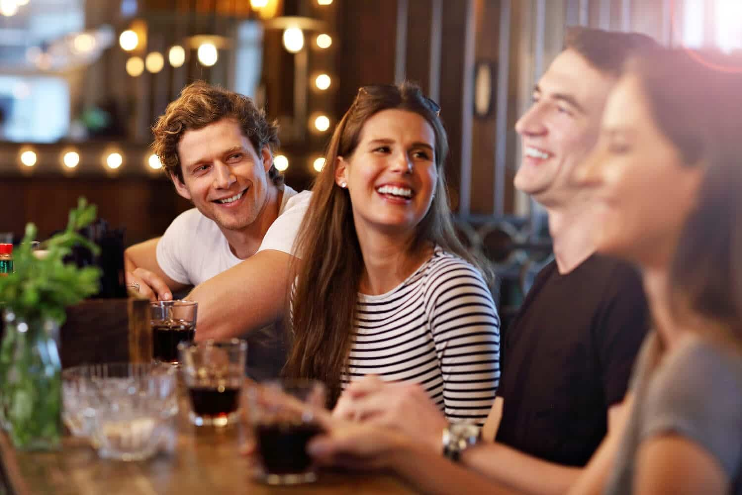 Shot of four friends laughing in a restaurant
